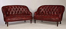 PAIR OF LEATHER NAPOLEON III STYLE LOVE SEATS