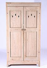 A MODERN TWO DOOR PINE ARMOIRE