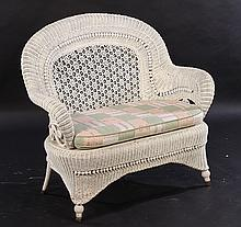 A VICTORIAN WICKER SETTEE LABELED HAYWOOD BROS C.1900