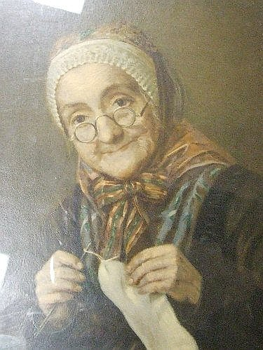 A chromolithographic print, Old Woman Sewing