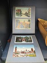 A postcard album containing a selection of