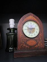 An Edwardian mantel clock having foliate inlay