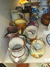A selection of Studio pottery jugs, various