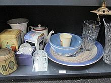 A shelf of ceramics and glassware, including