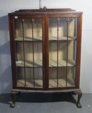 Bow Fronted Mahogany 2 Door Display Cabinet with blind fret decoration, small upstand, tall glazing bars, on ball & claw cabriole supports, wooden shelves