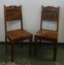 Pair Hardwood Hall Chairs on turned front supports, panelled back carved with elephants, serpentine top rail, wooden seats (2)