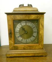 C20th Electric Mantel Clock in form of C18th burr & figured walnut bracket clock with silvered chapter ring, granulated centre, bishop? spandrels, blued hands, carrying handle to top, striking on gong