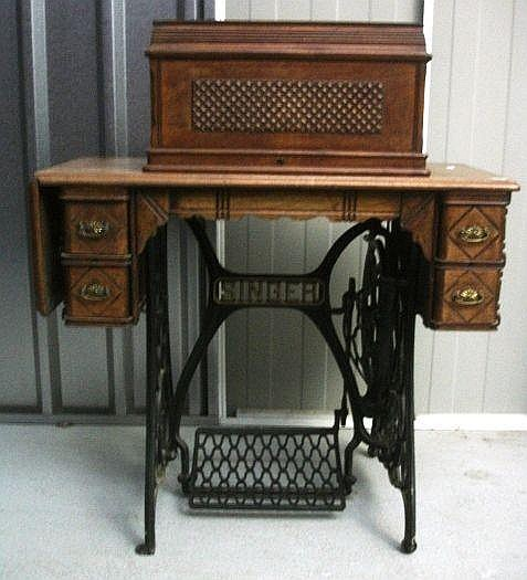 Singer Treadle Sewing Machine with walnut cabinet