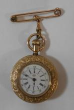 American Waterbury Watch Co. Evening Pocket Watch series N, top wind with bow, movement reg. March 1886, with engine turned case, decorative bezel, white enamelled dial with blued hands, Roman numerals, outer red Arabic numerals, yellow metal pin & suspension spinner