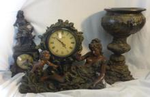 Juliana Quartz Mantel Clock with recumbent female & cherub decoration, Similar Mantel Clock with girl seated with lamb on her lap & Jardiniere Stand with c-scroll decoration & shepherdess scenes (3)