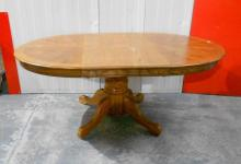 Circular Oak Dining Table on bold centre column with additional extension leaf, on 4 flat section cabriole style supports