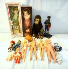 Action Man, Barbie style dolls, porcelain dolls, costume dolls, soft toy monkey etc.