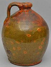 18TH CENT. N.E. REDWARE JUG WITH MOTTLED GREEN GLAZE