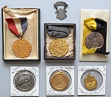 (7) MISC. VINTAGE ATHLETIC RIBBONED BADGES AND MEDALS