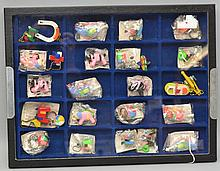 FLAT SHOWCASE COLLECITON OF (26) MISC. VINTAGE GERMAN PLASTIC KEY RING PUZZLES