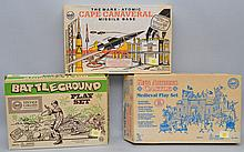 (3) VINTAGE MARX BOXED TOY PLAY SETS INC. BATTLEGROUND, KING ARTHUR'S CASTLE AND ATOMIC CAPE CANAVERAL MISSILE BASE