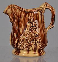 ROCKINGHAM TYPE GLAZED RELIEF DECORATED POTTERY PITCHER WITH HOUND HANDLE