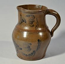 19TH CENT. STONEWARE PITCHER WITH LEAFY FLORAL DECORATION