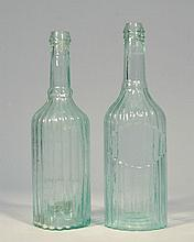 (2) AQUA CYLINDERS RIBBED WITH RECESSED PANELS CONDIMENT/PEPPER SAUCE TYPE BOTTLES