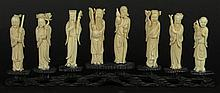 Set of Eight Chinese Ivory Figures of the Eight Daoist Immortals. Each Standing Figure Carved with its Attribute. Mounted on a Hardwood Stand. Very Good Condition. Ivory Figures Measure 3-3/4 Inches Tall by 1 Inch Wide. Measures with Stand 5-1/4