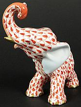 Vintage Hungarian Herend Painted and Gilt Porcelain Fishnet Rust Elephant Figure. Blue Backstamp (logo) to Underside. Good to Very Good Condition. Measures 3-1/2 Inches Tall and 3 Inches Wide. Shipping $28.00