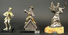 Three (3) Judaic Sterling Silver Figures Mounted on Hard Stone Bases. 2 Fiddler on the Roof Figures, 1 Moses and the Ten Commandments Figure. Each Marked 925 Sterling. Largest Measures 8 Inches Tall by 5 Inches Long and 2 Inches Wide. Shipping