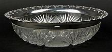Large American Brilliant Cut Glass Bowl with Gorham Sterling Silver Rim. The Rim is Signed With Gorham Logo Sterling D30. Losses to Bowl Rim which are Covered By The Rim. Measures 3-1/4 Inches Tall, 11-1/4 Inches Diameter. Shipping $88.00
