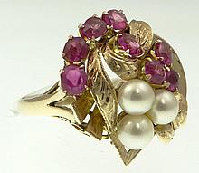 Vintage Mid Century 14 Karat Yellow Gold Ruby and Pearl Ring. Very Pretty Hand Chased Gold set with Oval Cut Rubies and Pearls. Signed 14K. Size 9-1/2 Inches. Weighs 4.55 Pennyweights. Very Good Condition. Shipping $28.00