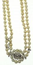 Vintage Double Strand Pearl Necklace with Diamond Clasp. The Pearls Ranging in Size From 5.7mm to 8.8mm. Nice Luster. The Clasp Set with Round Brilliant and Baguette Diamonds. Unsigned. Good Condition. Measures 16-1/2 Inches Length. Shipping $28.00