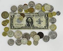 Lot of Vintage Currency. This Lot includes: One (1) Silver Certificate 1923, Seventeen (17) Kennedy Half Dollars ALL POST 1964. One (1) 1972 Eisenhower Dollar Coin, One (1) Liberty Silver Dollar 1922, Twenty Four (24) Various International Coins.