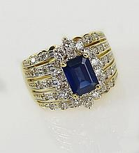 Lady's Levian 1.50 Carat Emerald Cut Sapphire, 1.0 Carat Round Cut Diamond and 18 Karat Yellow Gold Ring. Sapphire with Vivid Saturation of Color, Diamonds G Color, SI Clarity. Signed 18K Levian. Very Good Condition. Ring Size 7. Approx. Weight: 6.6