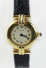 Lady's Vintage Cartier 18 Karat Yellow Gold Colisee Quartz Movement Watch with Crocodile Strap and 18 Karat Yellow Gold Buckle. Case Stamped and Numbered, Buckle Stamped. Minor Surface Wear from Normal Use otherwise Good Condition with Box. Running.