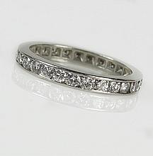 Lady's Round Cut Diamond and Platinum Eternity Band. Diamonds E-F Color, VS Clarity. Unsigned. Good Condition or Better. Ring Size 7-1/2. Approx. Weight: 2.6 Pennyweights. Shipping $26.00