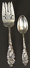 Two (2) Pieces of Gorham Sterling Silver in the Love Disarmed Pattern. 1 Cold Meat Serving Fork, 1 Teaspoon. Good to Very Good Condition. Weighs 4.288 Troy Ounces Total. Meat Fork Measures 7-7/8 Inches Long. Shipping $32.00