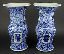 Pair of Chinese Porcelain Blue & White Vases, featuring Double Happiness Symbols and Butterflies. Both are signed with Calligraphy Signature. Each Drilled on Bottom, one with Hairline Cracks. Measures 15-3/4 Inches Tall, 9-1/4 Inches Wide. These Will