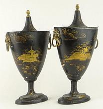 Pair Of 19th C Black Toleware Chestnut Urns. Each With an Asian Motif and Lions Head Ring Handles. Unsigned. Both Pieces With Wear and losses. These are being sold AS IS Please examine carefully prior to bidding. Measures 12-1/2 Inches Tall, 6-1/2