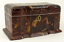 19th C English Tortoise Shell Tea Caddy. The interior with two lidded zinc foil-lined compartments for tea, each lid of tortoise with Ivory pull. The interior lid and base lined in Ivory. The lid with original felt backing. Unsigned. Damage to
