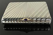 19/20th C Russian Silver Card Case With Sapphire Cabochon and Gold Clasp. Nice Ribbed Motif. Signed on Inside: AK, 84, (Moscow, Aleksandr Krivovichev). Gold Clasp Stamped 56. Very Good Condition. Measures 4 Inches by 3 Inches and Weighs 6.30 Troy
