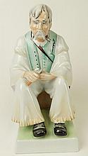 Hungarian Zsolnay Pecs Porcelain Figurine of a Woodcarver. Signed. Small Flake to left foot otherwise Good Condition or Better. Measures 12-3/4 Inches Tall and 7 Inches Wide. Proceeds of the sale of this item to benefit the Leidesdorf Foundation,