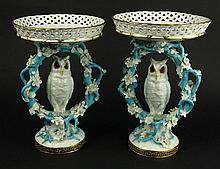 Pair 19th Century English Porcelain Figural Owl Pedestal Compotes With Reticulated Basket Tops. Probably Mintons. Unsigned. Restorations, Both With Typical Minor Losses. Measures 11 and 11-1/2 Inches Tall, 7-1/2 Inches Diameter Across the Top.