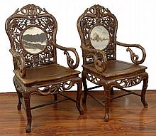 Pair of Heavily Carved Deep Relief Chinese Rosewood Arm Chairs. Nicely Carved Featuring Birds and Bamboo Motif and also with Inset Round Marble Scholars Screen Panels In Backs. Unsigned. Some Separation of Joints, a Bit of Fading but in overall good