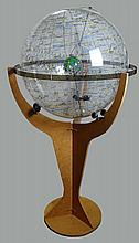 Enormous Modern Celestial Navigational Sphere on Stand. Lucite Sphere On Laminated Stand. Unsigned. The Sphere Turning Casters are a bit wobbly or in Good Condition. Measures 82 Inches Tall, 44 Inches Wide. Proceeds of the sale of this item to