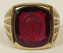 Men's 10 Carat Yellow Gold and Intaglio Cut Garnet Ring. Spartan Motif. Signed Siffari 10. Good Condition. Ring Size 12-1/2 and weighs Approx. 6.3 Pennyweights. Shipping $30.00
