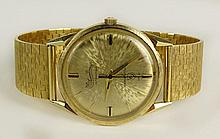 Man's Vintage Lucien Picard 14 Karat Yellow Gold Seashark Automatique Watch with Italian 18 Karat Yellow Gold Bracelet. Case and Bracelet Clasp Signed. Surface Wear from Normal Use. Watch Appears to be Running. The Gallery does not Warranty the