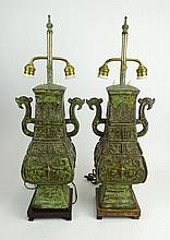 Pair Chinese Archaistic Bronze Vases Mounted as Lamps. Rectangular Shape Vase with Handles, Molded with Characters, Birds and Geometric Forms on Wooden Base. Sliding Tube to adjust Lamp Shade. Very Good Condition. Vases Measure 17-1/2 Inches Tall 10