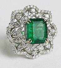 GIA Certified 7.08 Carat Octagonal Step Cut Emerald, approx. 3.72 Carat Round Cut Diamond and 18 Karat White Gold Ring. Emerald with Vivid Saturation of Color. Diamonds E-F Color, VS1-SI1 with a few SI2 Clarity. Emerald Measures 12.92 x 11.12 x 7.17