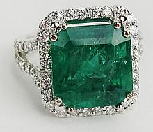 GIA Certified 9.71 Carat Octagonal Step Cut Emerald, approx. 1.21 Carat Round Cut Diamond and 18 Karat White Gold Ring. Emerald with Vivid Saturation of Color Measures 12.57 x 12.36 x 9.28 mm. Diamonds E-F Color, VS1 Clarity. Unsigned. Ring Size