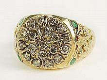 Vintage 14 Karat Yellow Gold, Diamond and Emerald Ring. Pretty Filigree Motif with a Round Pave Set with J-K Diamonds, Flanked by 2 Emeralds on Each Side. Signed 14. Good Condition. Ring Size 12. Weighs Approx. 4.8 Pennyweights. Shipping $30.00