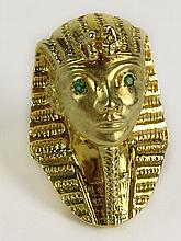 Vintage Egyptian Revival 14 Karat Yellow Gold and Emerald Tutankhamun Ring. Signed 14K. Good Condition. Ring Size 8. Approx. 14.3 Pennyweights. Shipping $30.00