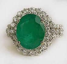 Lady's Fine Quality Approx. 5.08 Carat Oval Cut Colombian Emerald, 1.80 Carat Round Cut Diamond and 18 Karat White Gold Ring. Emerald with Vivid Saturation of Color Measures 13 x 10mm. Diamonds E-F Color, VS1 Clarity. Signed 18K. Very Good Condition.